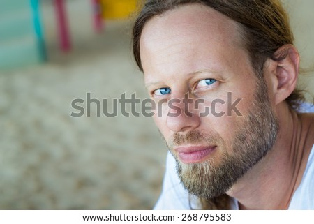 Portrait of a handsome bearded man with blue eyes - stock photo