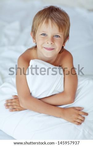 Portrait of a handsome boy awakened - stock photo