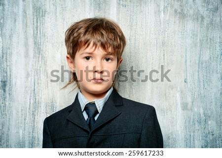 Portrait of a handsome boy in elegant suit. Education. Copy space.  - stock photo