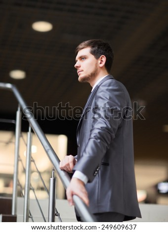 Portrait of a handsome business man in the office - stock photo