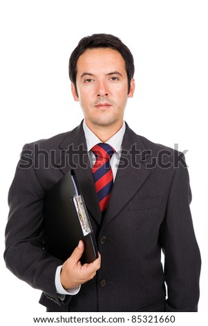 Portrait of a handsome business man standing with binder. Isolated on white. - stock photo