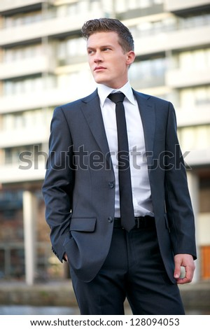 Portrait of a handsome businessman in the city - stock photo