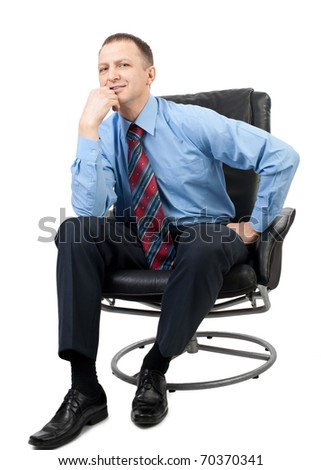 Portrait of a handsome businessman sitting in a armchair and  thinking, over white background - stock photo