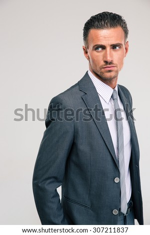 Portrait of a handsome businessman standing isolated on a white background - stock photo