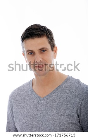 Portrait of a handsome Caucasian middle-aged man with blue eyes, smiling and looking at camera, isolated on white background - stock photo