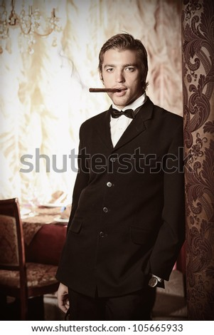 Portrait of a handsome groom on his wedding celebration. - stock photo