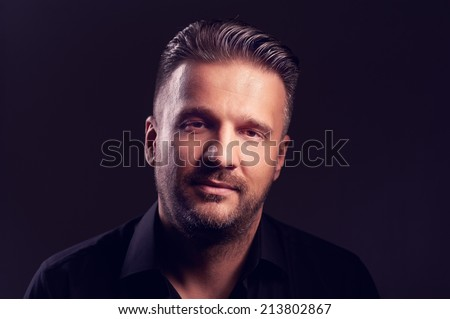 Portrait of a handsome happy male looking at the camera and smiling - stock photo