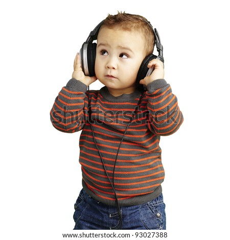portrait of a handsome kid listening to music looking up over white - stock photo
