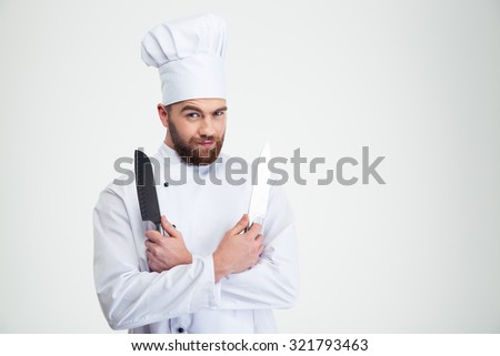 Portrait of a handsome male chef cook holding knifes isolated on a white background - stock photo