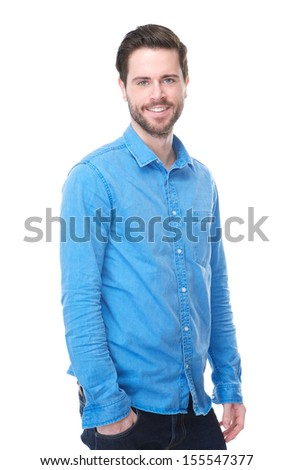 Portrait of a handsome male fashion model smiling in blue jeans and shirt - stock photo