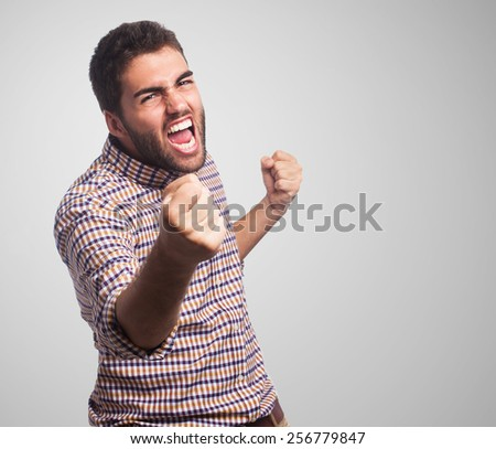 portrait of a handsome man doing a victory gesture - stock photo