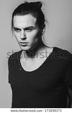 Portrait of a handsome man in studio, Black and white photographs - stock photo