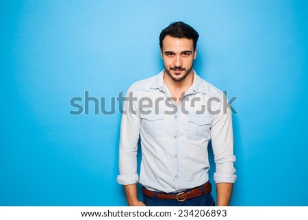 portrait of a handsome man on a blue background - stock photo