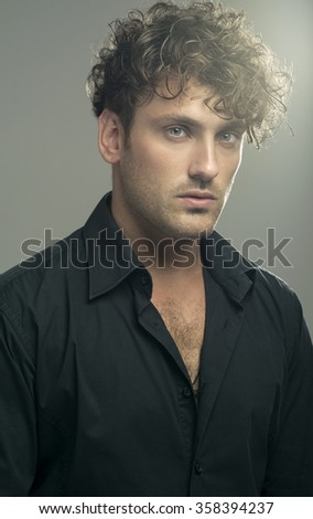 Portrait of a handsome man over grey background - stock photo
