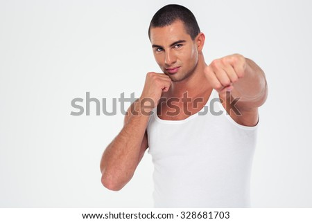 Portrait of a handsome man punching at camera isolated on a white background - stock photo