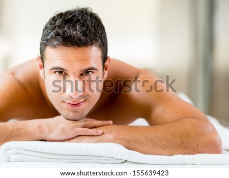 Portrait of a handsome man relaxing at the spa  - stock photo