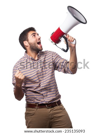 portrait of a handsome man shouting with a megaphone - stock photo