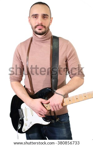 Portrait of a handsome man with a beard and a guitar in his hands isolated on white - stock photo