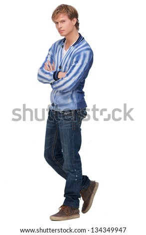 Portrait of a handsome man with arms crossed - stock photo