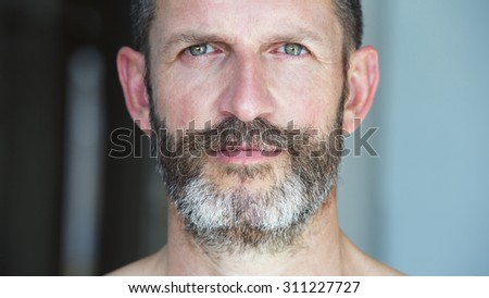 portrait of a handsome man with beard - stock photo