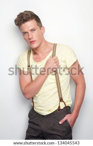 Portrait of a handsome man with suspenders - stock photo