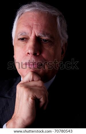 Portrait of a handsome mature businessman,  on black background, studio shot - stock photo