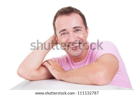 Portrait of a handsome middle-age man smiling, on white background. Studio shot - stock photo