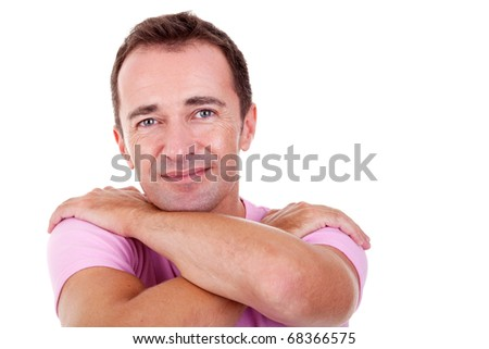 Portrait of a handsome middle-age man, with arms crossed, on white background. Studio shot - stock photo