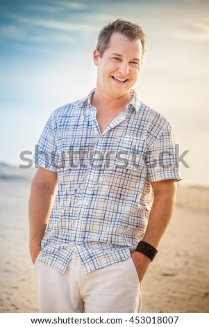 Portrait of a handsome middle aged man outdoor at the beach portrait - stock photo