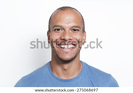 Portrait of a handsome mixed race man smiling to camera - stock photo