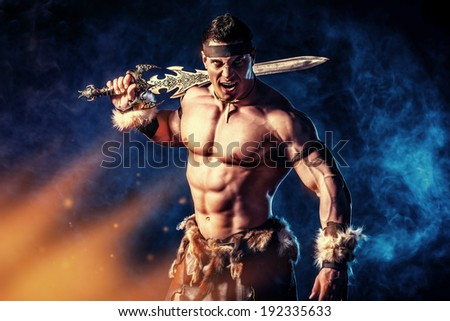 Portrait of a handsome muscular ancient warrior with a sword. - stock photo