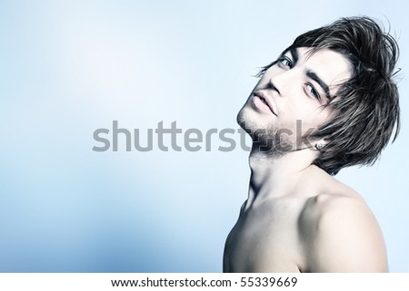 Portrait of a handsome muscular young man. Shot in a studio. - stock photo