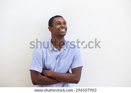 Portrait of a handsome young african american man smiling against white background  - stock photo