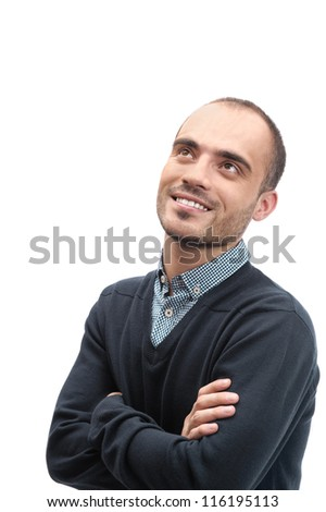 Portrait of a handsome young business man looking up smiling relaxing and day dreaming isolated - stock photo