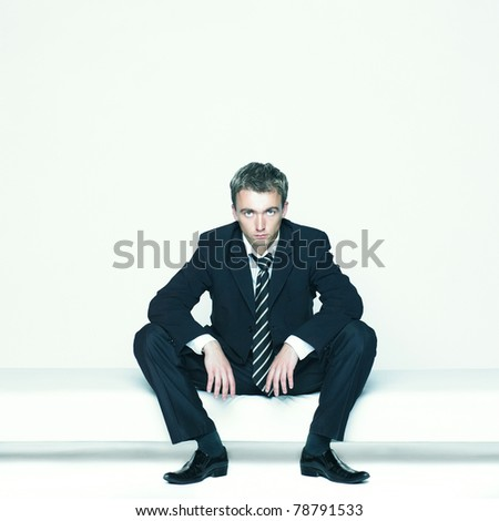 Portrait of a handsome young business man on white background - stock photo