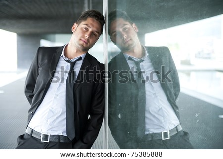 Portrait of a handsome young business man outdoors - stock photo