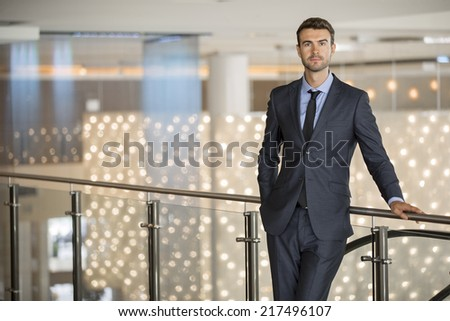 Portrait of a handsome young businessman in a shopping center - stock photo