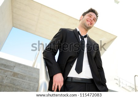 Portrait of a handsome young businessman smiling - stock photo