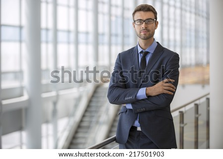 Portrait of a handsome young businessman wearing glasses - stock photo