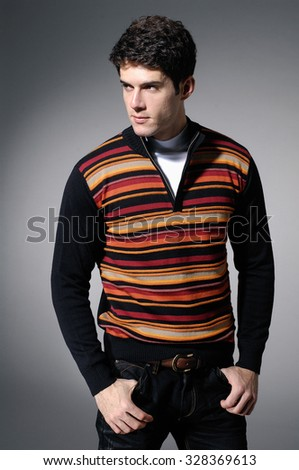 Portrait of a handsome young male in sweater - stock photo