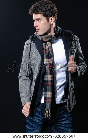 Portrait of a handsome young male on black background - stock photo