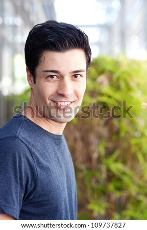 portrait of a handsome young male student on college campus - stock photo
