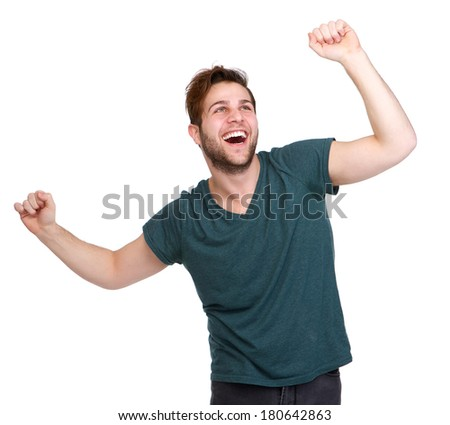 Portrait of a handsome young man cheering with arms raised isolated on white background - stock photo