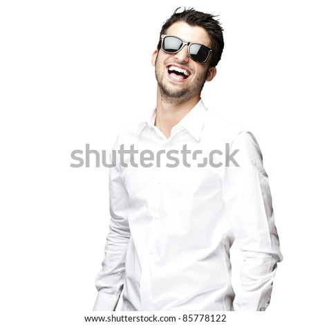 portrait of a handsome young man enjoying over white background - stock photo