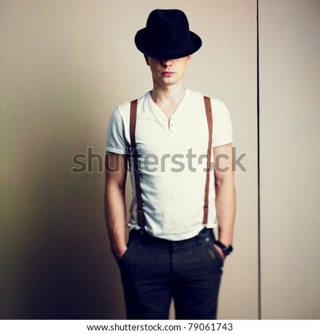 Portrait of a handsome young man in hat - stock photo