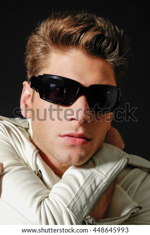 Portrait of a handsome young man in sunglasses. - stock photo