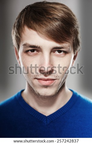 Portrait of a handsome young man in the studio - stock photo