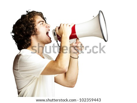 portrait of a handsome young man shouting with megaphone against a white background - stock photo