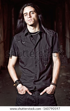 Portrait of a handsome young man with long hair - stock photo