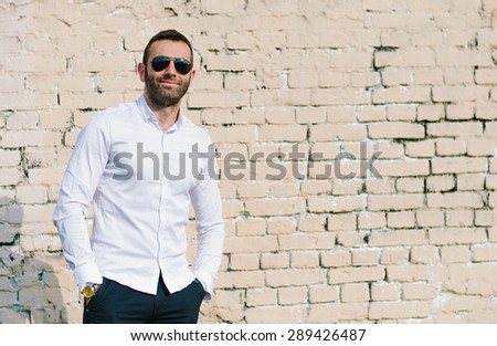 portrait of a handsome young man with sunglasses  - stock photo